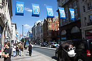 Flags hanging above Oxford Street in support of the NHS key workers as the Coronavirus lockdown measures are set to ease further, the west end starts to fill with people as they return to the shopping district and the quiet city starts coming to an end on 22nd June 2020 in London, England, United Kingdom. As of today the government has relaxed its lockdown rules, and is allowing some non-essential shops to open with individual shops setting up social distancing queueing systems.
