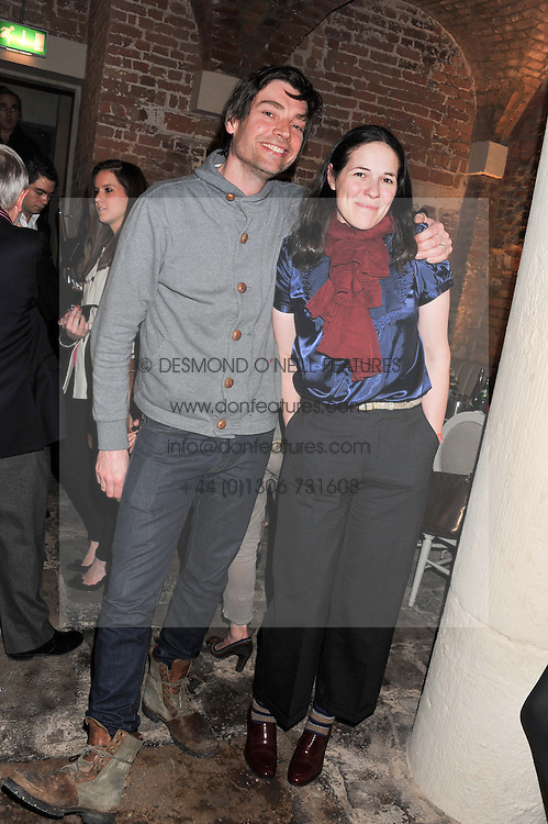 ALEX JAMES and his wife CLAIRE at an evening of cheesey culinary delights & champagne hosted by Alex James, Yasmin Mills and Elaine Foran held at Aubaine, 31 Dover Street, London on 20th March 2012.