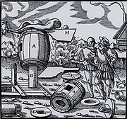 Mine ventilation shaft topped with a device to extract the stale air from the mine.  H is a vane to make the barrel revolve so that is always facing in the optimum wind direction.  From 'De re metallica', by Agricola, pseudonym of Georg Bauer (Basle, 1556).  Woodcut.