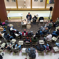 Jeweler Lyndon Tsosie, 50, top center, introduces himself to the audience in attendance for his demonstration at UNM-Gallup Gurley Hall on Wednesday.