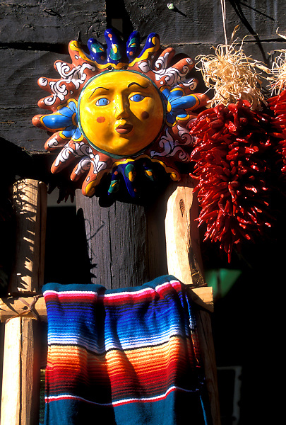 Painted Ceramic Sun, Chili Peppers and an American Indian Rig