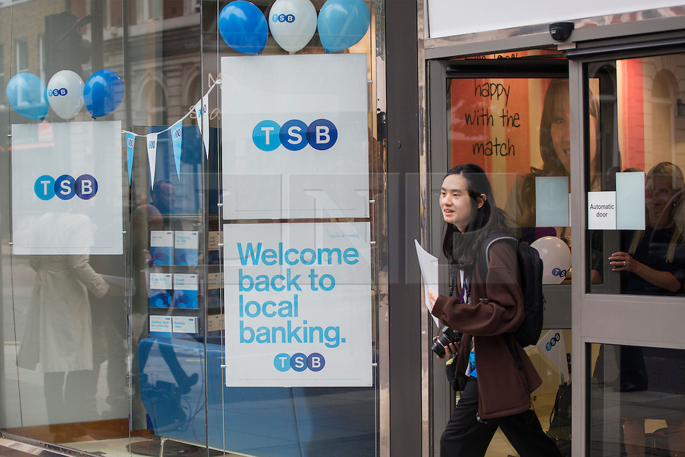 © licensed to London News Pictures. London, UK 09/09/2013. A TSB branch opens in London on the bank's first day of trading as more than 600 branches and eight million accounts have been split from Lloyds in order to meet European competition rules. Photo credit: Tolga Akmen/LNP