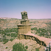 1. When was this photo taken?<br /> <br /> Easter 2006<br /> <br /> 2. Where was this photo taken?<br /> <br /> Palo Duro Canyon, TX<br /> <br /> 3. Who took this photo?<br /> <br /> Jennifer Mitchell<br /> <br /> 4. What are we looking at here?<br /> <br /> This is the Lighthouse, the famous rock formation at Palo Duro Canyon in West Texas.<br /> <br /> 5. How does this old photo make you feel?<br /> <br /> This photo makes me feel both sad and hopeful. I took this picture during an Easter weekend of soul searching . . . was I actually going to move from West Texas to New York City? (By August of that same year, I was living in Brooklyn. I had no job and knew 2 people). Thirteen years later, I am still in Brooklyn! I miss that girl who would just up and decide to move! It was wonderful, though, to be reminded of her and that part of my spirit.<br /> <br /> 6. Is this what you expected to see?<br /> <br /> I honestly had no idea what to expect!<br /> <br /> 7. What kind of memories does this photo bring back?<br /> <br /> This picture reminds me of the stark beauty of West Texas: the big ole skies with lots of stars. Landscapes of browns and reds and greens and blues, punctuated with bright wildflowers. Also, the love and laughter I experienced while living there. I count my friends from West Texas as life long ones.<br /> <br /> 8. How do you think others will respond to this photo?<br /> <br /> I suspect that it might evoke a nostalgia for the West, both the scenery and the spirit. I know it does for me!