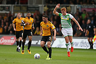 Padraig Amond of Newport county © breaks away from Matt Worthington of Yeovil Town ® .EFL Skybet football league two match, Newport county v Yeovil Town at Rodney Parade in Newport, South Wales on Saturday 7th October 2017.<br /> pic by Andrew Orchard,  Andrew Orchard sports photography.