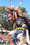 Native American dancer age 55 wearing ceremonial clothing. Como Park's Traditional Powwow St Paul Minnesota USA