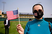17 SEPTEMBER 2020 - DES MOINES, IOWA: ISABEL MARTINEZ MORALES, originally from Colombia, during a naturalization ceremony at Principal Park, a minor league baseball stadium in downtown Des Moines. About 75 people from 32 countries were naturalized as US citizens Thursday. It was the last citizenship ceremony in Des Moines before citizenship fees dramatically increase. Starting Oct. 2, the fee to apply for U.S. citizenship will increase from $640 to $1,160 if filed online, or $ 1,170 in paper filing, a more than 80% increase in cost. Advocates for immigration are afraid the new fees will be too expensive for many immigrants and say it's an effort by the Trump Administration to limit the number of new citizens welcomed into the United States. Because of the COVID-19 pandemic, there has been dramatic slow down in the number of naturalization ceremonies this year.        PHOTO BY JACK KURTZ