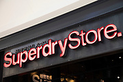 Sign for the high street clothing brand Superdry in Birmingham, United Kingdom.