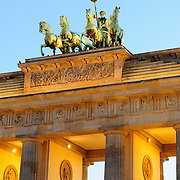 The Quadriga atop the Brandenburg Gate (Brandenburger Tor) in Berlin, Germany. It is a chariot drawn by four horses driven by Victoria, the Roman goddess of victory.