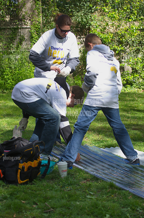 Mary Ericson with sons Kyle and Nicholas - Wellpoint Community Service Day   New Haven CT
