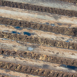 Aerial views of artistic patterns in the earth. Aerial view of Dirt, compost in rows