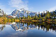 Mount Shuksan is reflected in Picture Lake during the Fall in the Mount Baker Wilderness, Whatcom County, Washington State, USA