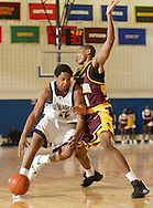 Newburgh Free Academy's Justin Rutty, left, dribbles the ball around Kevin Jones of Mount Vernon during a Class AA state tournament game at SUNY New Paltz on March 9, 2007.