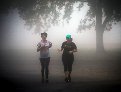 18 February 2014. New Orleans, Louisiana. <br /> Fog from the Mississippi river rolls onto the levee at the Fly in Uptown New Orleans.<br /> Photo; Charlie Varley
