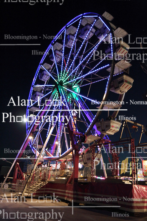 07 August 2015:   McLean County Fair - ferris wheel<br /> <br /> This image was produced in part utilizing High Dynamic Range (HDR) processes.  It should not be used editorially without being listed as an illustration or with a disclaimer.  It may or may not be an accurate representation of the scene as originally photographed and the finished image is the creation of the photographer.