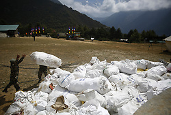 May 27, 2019, Namche Bazar, Nepal: Nepalese Army load garbage collected from the high camps of Mount Everest during the Everest clean-up campaign at Namche Bazar in Nepal. (Credit Image: © Skanda Gautam/ZUMA Wire)