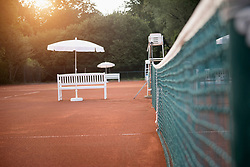 Tennis court with net in the morning, Bavaria, Germany