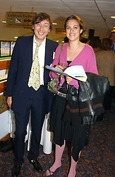 The HON.ADAM MACMILLAN and his niece the HON.REBECCA MACMILLAN at a night of Greyhound Racing in aid of The Royal Marseden Cancer Campaign and The Trustees of the Head & Neck Cancer Reseach Trust held at Wimbledon Greyhound Stadium, Plouh Lane, London SW17 on 3rd May 2005.<br /><br />NON EXCLUSIVE - WORLD RIGHTS