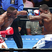 Devon Alexander (L) and Andre Berto exchange blows during a Premier Boxing Champions fight on Saturday, August 4, 2018 at the Nassau Veterans Memorial Coliseum in Uniondale, New York.  (Alex Menendez via AP)