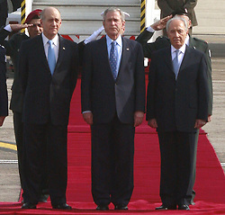 Israeli Prime Minister Ehud Olmert (left), Israeli President Shimon Peres (right) and U.S. President George W. Bush (center) stand together at a welcoming ceremony upon Bush's arrival at Ben Gurion International Airport in Tel Aviv, Israel on January 9, 2008. Bush landed in Israel today on the first visit of his presidency aimed at bolstering recently-revived peace talks. Photo by Nati Shohat/Flash 90/MCT/ABACAPRESS.COM