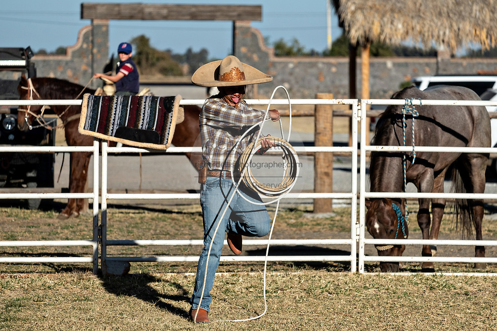 A Charro practices roping tricks during a family charro practice session in the Jalisco Highlands town of Capilla de Guadalupe, Mexico.