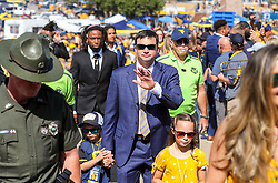 Oct 2, 2021; Morgantown, West Virginia, USA; West Virginia Mountaineers head coach Neal Brown walks with his kids into the stadium prior to their game against the Texas Tech Red Raiders at Mountaineer Field at Milan Puskar Stadium. Mandatory Credit: Ben Queen-USA TODAY Sports