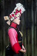 Ann-Cathrin is wearing a traditional Vierländer Bridal Costume in Neuengamme in Hamburg, Germany on June 25, 2017.<br /> <br /> Vierlande was always known as the flower garden in Germany, an area that had many flower farmers. The bridal crown represent the flowers of the area.<br /> <br /> Men already abandoned the traditional clothing after the war after 1870. Women wore the traditional dresses until after WWI. During and after the war, women sold their dresses and costumes to women from the city of Hamburg who wore the dresses to the markets. Vierlande always stood for good quality, so people dressed up on the markets with Vierländer Costumes to push the value of their products. Even the company Rama advertised their margarine products with a picture of a young women in traditional Vierländer Costume in the beginning of 1900.