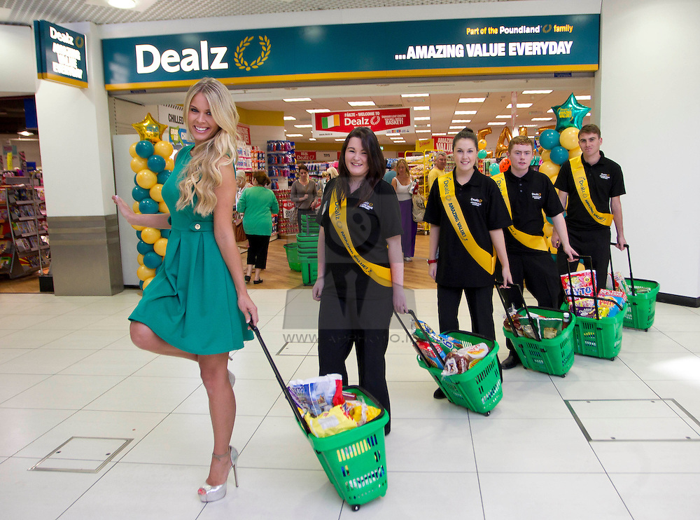 Repro Free: 30/08/2012.Top model Karena Graham is pictured getting a helping hand by Dealz staff LAura Spain, Lisa Murphy, Sean Fitzimmons and ian Tuohy at the opening of the new Dealz store in Tallaght, the fifteenth Dealz store to open to date. Located at Unit 110, The Square, Tallaght, Dublin 24, Dealz is creating 30 jobs in the Dublin area, bringing the total number of jobs created in Ireland to over 430. Pic Andres Poveda CPR..The new store has over 4,000 sq ft of retail space and offers customers a wide range of branded products from health and beauty, food and drink to clothing accessories. Dealz is proudly supporting Irish suppliers and are stocking a range of products produced in Ireland, such as milk, eggs, crisps and cakes...Commenting at the new store opening, Dealz Senior Business Manager Leonard Brassel said:  ?We are very excited to be expanding the Dealz portfolio in Ireland with the opening of our new store in Tallaght. The new store is the fifteenth Dealz store to open in Ireland to date and has created 30 new jobs for the Dublin area. Dealz is committed to bringing amazing value every day to customers and we are looking forward to expanding further across the Republic of Ireland. Dealz Tallaght will offer customers everything they need including great seasonal ranges for Back to School and Halloween.? ..ENDS..For further information, please contact:.Nadia Pallas Pettitt and Ruth Kavanagh WHPR, 01 6690030.087 203 8985 (NP) and 086 364 0483 (RK).nadia.pallaspettitt@ogilvy.com or ruth.kavanagh@ogilvy.com