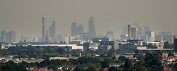© Licensed to London News Pictures. 24/08/2016. London, UK. London skyline is seen through a haze of pollution from the west. London is experiencing a second day of high temperatures with a peak of 30 degrees expected. Photo credit: Peter Macdiarmid/LNP