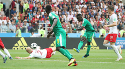MOSCOW, June 19, 2018  Idrissa Gana Gueye (2nd R) of Senegal shoots during a Group H match between Poland and Senegal at the 2018 FIFA World Cup in Moscow, Russia, June 19, 2018. (Credit Image: © Cao Can/Xinhua via ZUMA Wire)