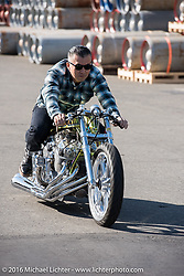 Kiyo Mitsuhiro of Kiyo's Garage in Gardenam, CA tests his twin-4-cylinder Honda drag bike at the Yokohama docks where the invited custom builder's bikes from the USA were unloaded prior to the Mooneyes Yokohama Hot Rod & Custom Show. Yokohama, Japan. December 3, 2016.  Photography ©2016 Michael Lichter.