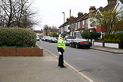 © Licensed to London News Pictures. 31/03/2019. London, UK. Crime scene on Aberdeen Road in Edmonton, north London where a woman was stabbed just after 7pm on Saturday 30 March. According to the Met Police, victim is in a critical condition. Police guard cordons around the crime scene. Photo credit: Dinendra Haria/LNP