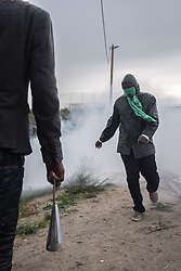 October 1, 2016 - Calais, France - Refugees in the jungle of Calais claimed their rights to pass in Great Britain. Singing  ''UK'' like one man, they will be blocked and pushed back in the camp by teargas and flashball fired by the anti-riot Policemen. Calais in Setques, France on October 1 ,2016. (Credit Image: © Julien Mattia/NurPhoto via ZUMA Press)