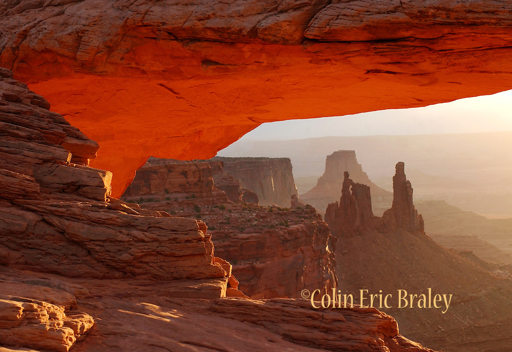 Mesa Arch in Canyonlands National Park, Utah, glows during s sunrise.