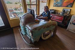 "Craig Gacom at his very cool desk at his ""Rusty Ranch"" on Thursday of Arizona Bike Week 2014. USA. April 4, 2014.  Photography ©2014 Michael Lichter."