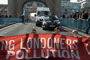 Stop Killing Londoners, Cut Air Pollution protest blocks Tower Bridge on 30th October 2017 in central London, England, United Kingdom. Metropolitan police were in attendance talking to the protesters before eventually arresting them all. Stop Killing Londoners: Cut Air Pollution runs a campaign of peaceful civil disobedience, blocking the most polluted streets in the capital until authorities agree to a meeting to seriously consider their proposals.