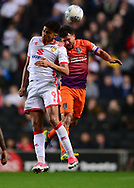 Osman Sow of MK Dons (l) and David Buchanan of Northampton Town battle for a header .EFL Skybet football league one match, MK Dons v Northampton Town at the Stadium MK in Milton Keynes on Tuesday 26th September 2017.<br /> pic by Bradley Collyer, Andrew Orchard sports photography.