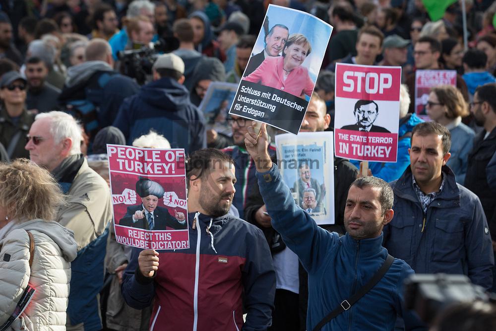 """Berlin, Germany - 28.09.2018<br /> <br /> Protest on the occasion of the Turkish state visit. Thousands of people protest in Berlin with the slogan """"Erdogan not welcome"""". According to organizers about 8000 people took part in the protest, the police spoke of about 6000 participants.<br /> <br /> Protest anlaesslich des Erdogan-Staatsbesuchs. Tausende Menschen protestieren in Berlin unter dem Motto """"Erdogan not welcome"""". Laut veranstaltern beteiligten sich etwa 8000 Menschen an dem Protest, die Polizei sprach von ca 6000 Teilnehmern.<br /> <br /> Photo: Bjoern Kietzmann"""