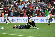 Derby County goalkeeper Kelle Roos (21) lies on the pitch, dejected  after the final whistle during the EFL Sky Bet Championship play off final match between Aston Villa and Derby County at Wembley Stadium, London, England on 27 May 2019.