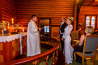 Lutheran priest (pastor) performing a wedding ceremony in Plassen Church (kirke), a wooden (stave) church originally built in 1879. It burnt to the ground in 1904 and was rebuilt in 1907. Trysil, Norway.