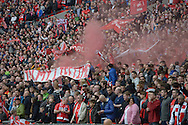 Liverpool fans launch smoke flairs before k/o. The FA Cup, semi final match, Aston Villa v Liverpool at Wembley Stadium in London on Sunday 19th April 2015.<br /> pic by John Patrick Fletcher, Andrew Orchard sports photography.