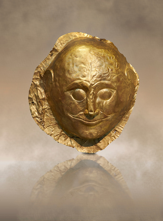 Mycenaean gold death mask, Grave Cicle A, Mycenae, Greece. National Archaeological Museum of Athens.<br /> <br /> This death mask is typical of the other Mycenaean gold death masks fround in Grave V. made from a sigle sheet of gold the shape of the face would have been hammered ot against wood. two holes either side of the gold mask allowed it to be held over the dead mans face. As weapons were found in the graves of Grave Circle A at Mycenae, those buried here wer warriors and maybe kings as the grave goods buried with them were of great value. 16th century BC .<br /> <br /> If you prefer to buy from our ALAMY PHOTO LIBRARY  Collection visit : https://www.alamy.com/portfolio/paul-williams-funkystock/mycenaean-art-artefacts.html . Type -   Athens    - into the LOWER SEARCH WITHIN GALLERY box. Refine search by adding background colour, place, museum etc<br /> <br /> Visit our MYCENAEN ART PHOTO COLLECTIONS for more photos to download  as wall art prints https://funkystock.photoshelter.com/gallery-collection/Pictures-Images-of-Ancient-Mycenaean-Art-Artefacts-Archaeology-Sites/C0000xRC5WLQcbhQ