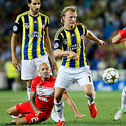 Fenerbahce's Dirk Kuyt (R) and Spartak Moscow's Demy de Zeeuw (L) during their UEFA Champions League Play-Offs, 2nd leg soccer match Fenerbahce between Spartak Moscow at Sukru Saracaoglu stadium in Istanbul Turkey on Wednesday 29 August 2012. Photo by TURKPIX