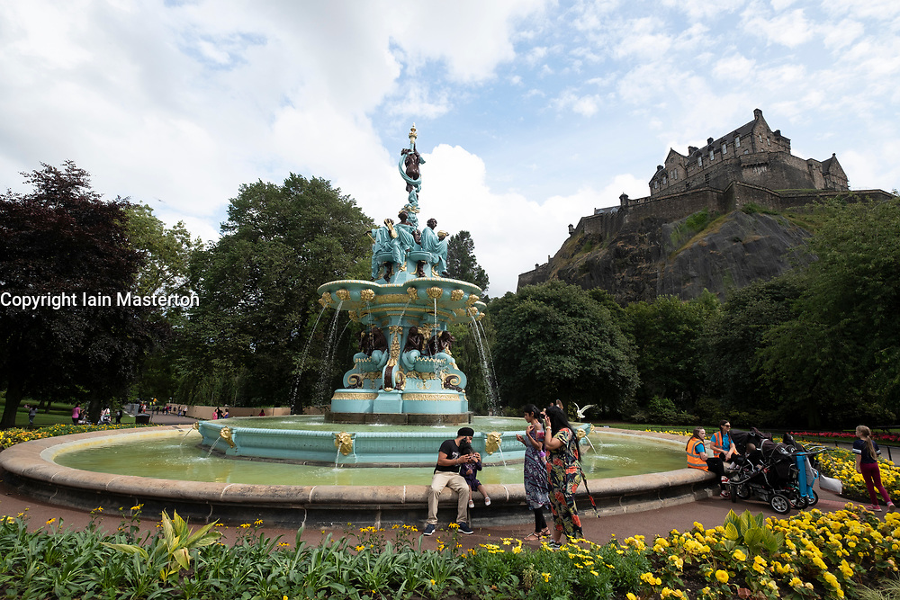 Newly renovated Ross fountain in Princes Street gardens at foot of Edinburgh Castle.
