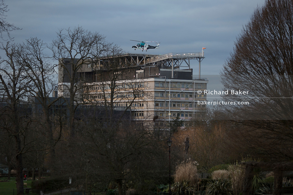 Seen from Ruskin Park in Lambeth south London, the Agusta-Westland AW-169 helicopter (G-KSSC) of the Kent Air Ambulance lifts off from the helipad of Kings College Hospital in Camberwell, on 11th February 2019, in London, England.