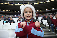 a young West Ham United fan wearing a Christmas hat looks on. Premier league match, West Ham Utd v Hull city at the London Stadium, Queen Elizabeth Olympic Park in London on Saturday 17th December 2016.<br /> pic by John Patrick Fletcher, Andrew Orchard sports photography.