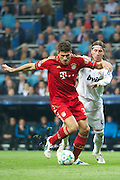 Champions League semi final second leg soccer match between Real Madrid and FC Bayern Munich at the Santiago Bernabeu stadium in Spain - <br /> MADRID 25/04/2012<br /> ESTADIO SANTIAGO BERNABEU.<br /> half final, Halbfinale, Semifinale,  CHAMPIONS LEAGUE<br /> REAL MADRID 2 - BAYERN 1<br /> picture: MARIO GOMEZ. SERGIO RAMOS.- fee liable image, copyright © ATP QUEEN INTERNACIONAL<br /> <br /> Real MADRID vs Fc BAYERN Match 2:1 und 3:1 im Elfmeterschieflen - and 3:1 in penalty shooting - Queen photographer Fernando ALVAREZ