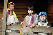 Portrait of a Kayan Padaung ethnic minority woman with her grand-daughters on 26th March 2016 in Kayah State, Myanmar. Myanmar is one of the most ethnically diverse countries in Southeast Asia with 135 different indigenous ethnic groups. There are over a dozen ethnic Karenni subgroups in the region including the Kayan who are perhaps the best known due to the traditional practice of the Kayan women extending their necks with brass rings