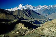 Jharkot Dzong (fortress / gompa) near Muktinath, winter, with Dhaulagiri (8167m) behind, Annapurna Himal, near Mustang, Nepal Himalaya