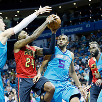 01 November 2015: Atlanta Hawks guard Kent Bazemore (24) goes for the layup past Charlotte Hornets forward Nicolas Batum (5) and Charlotte Hornets center Frank Kaminsky III (44) during the Atlanta Hawks 94-92 victory over the Charlotte Hornets, at the Time Warner Cable Arena, in Charlotte, North Carolina, USA.