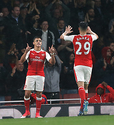 16 May 2017 London : Premier League Football : Arsenal v Sunderland :<br /> Alexis Sanchez celebrates his first goal with Arsenal colleague Granit Xhaka.<br /> Photo: Mark Leech